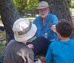 Curator Grant Keddie and a group of kids at Camp Dinosaur