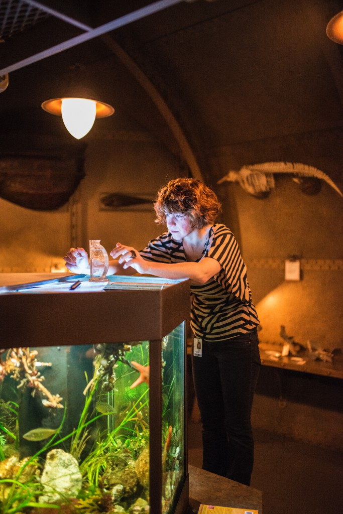 Exhibit Technician Jana Stefan uses a salinity hydrometer to ensure that the water in the Ocean Station aquarium is safe for all the critters that call it home.